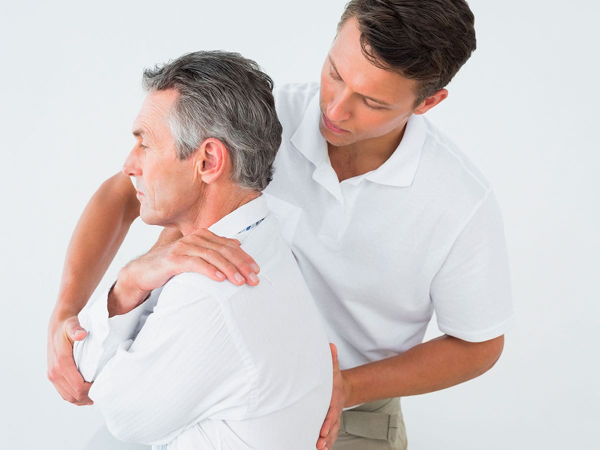 Professional Physiotherapist Correcting A Posture In Brooklyn