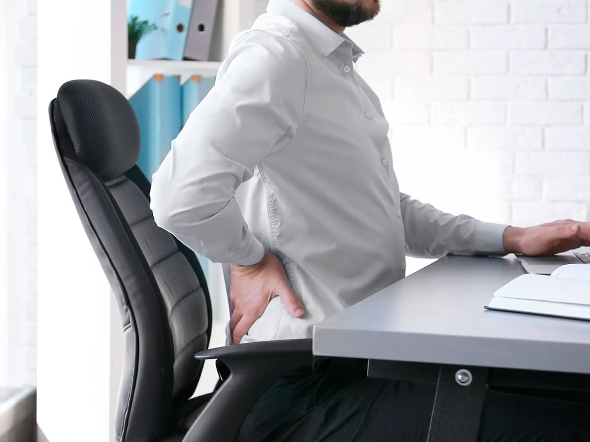 Man Having Back Pain For Having A Bad Posture In Brooklyn
