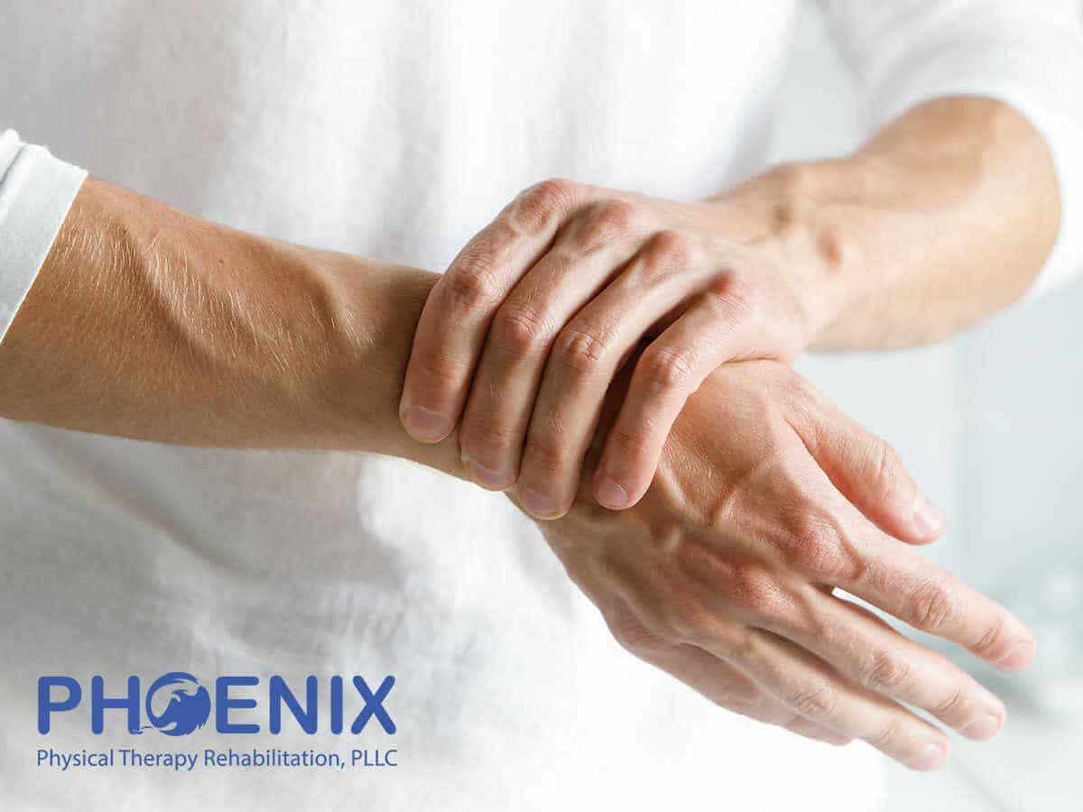 Man Suffering From Wrist And Hand Pain In Rosedale, NY
