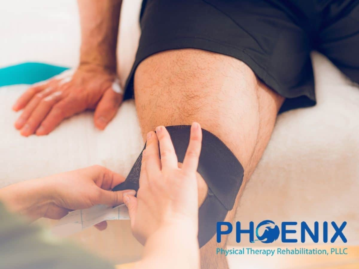 A physical therapist placing kinesio tape on a man's knee in Levittown, NY